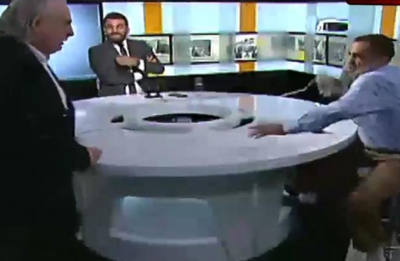 A debate on Lebanese television turns into a brawl.  (photo credit: screenshot)