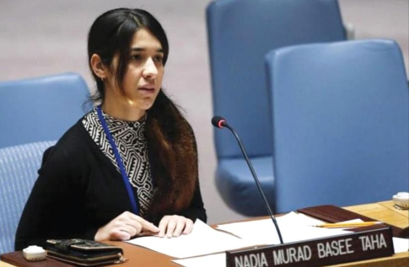 Yazidi human rights activist Nadia Murad speaks to members of the UN Security Council (photo credit: REUTERS)