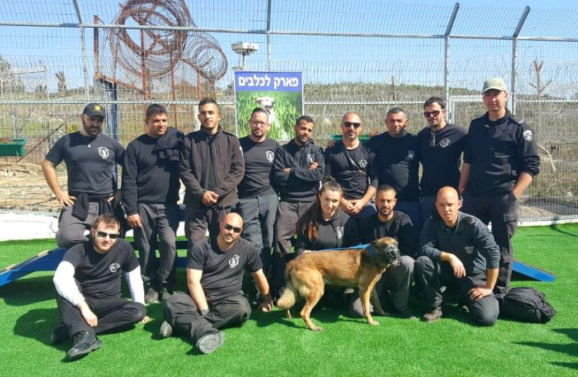 Prison service employees at the inauguration of the security dogs retirement home in Damon Prison on July 4, 2017. (photo credit: ISRAEL PRISON SERVICE)