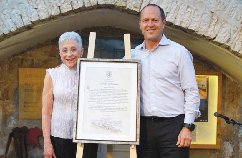 Mayor Nir Barkat presents the Jerusalem Builder Award to the Charles and Lynn Schusterman Foundation founder last week (photo credit: SNIR KAZIR)