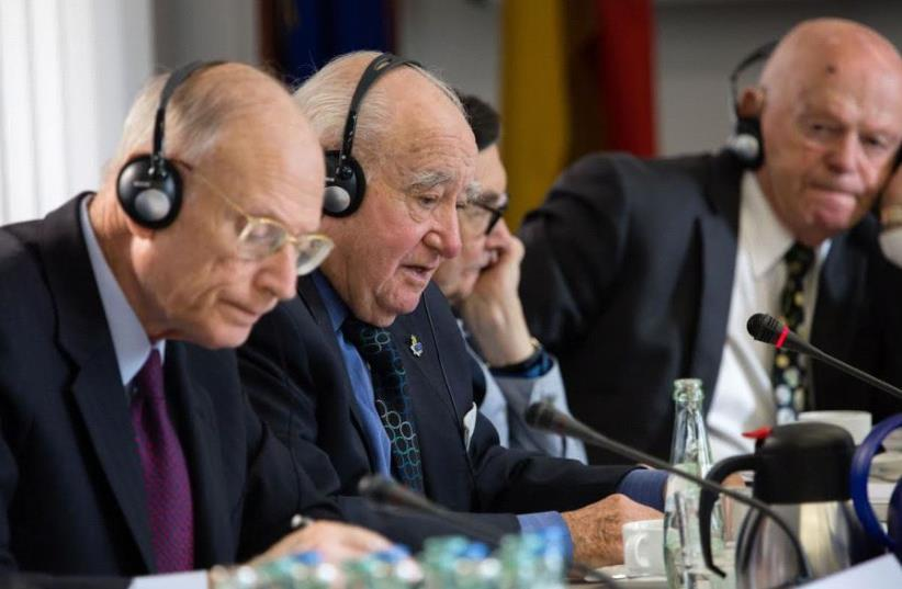 Ambassador Eizenstat is the closest to camera Next to him are Auschwitz survivor, Roman Kent and Marian Turski last is Ben Helfgott, survivor of Buchenwald (photo credit: MARCO LIMBERG)