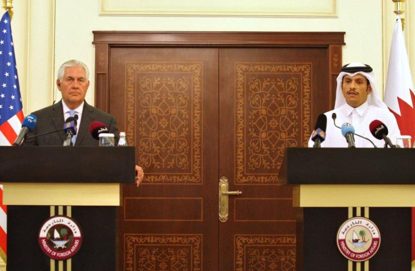 Qatar's foreign minister Sheikh Mohammed bin Abdulrahman al-Thani (R) and US Secretary of State Rex Tillerson attend a joint news conference in Doha, Qatar, July 11, 2017 (photo credit: REUTERS)