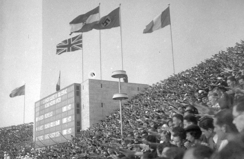 Spectators giving the Nazi salute during one of the 1936 Berlin Summer Olympics medal ceremonies (photo credit: FOTO:FORTEPAN / LŐRINCZE JUDIT VIA CC BY-SA 3.0)