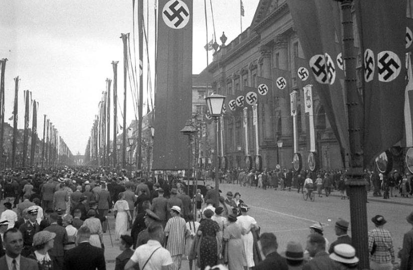 The Nazi regime organized the mass displays of Nazi propaganda and nationalist symbols across Germany during the 1936 Berlin Summer Olympics events (photo credit: FOTO:FORTEPAN / LŐRINCZE JUDIT VIA CC BY-SA 3.0)