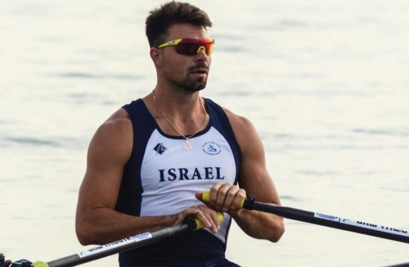 Israeli rower Dani Fridman won his second gold medal of the 20th Maccabiah yesterday, finishing first in the singles sculls in the Kinneret. (photo credit: ALON OZ/DANIEL ROWING CENTRE)