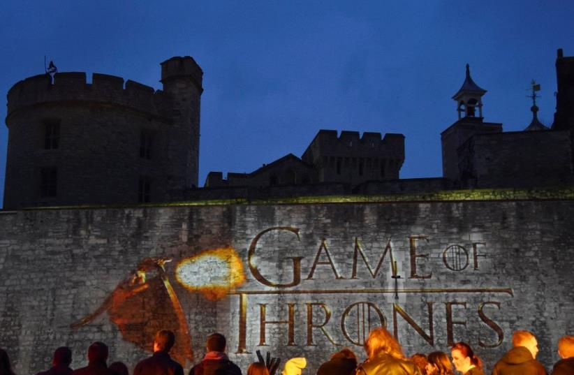 Fans wait for guests to arrive at the world premiere of the television fantasy drama Game of Thrones series 5, at The Tower of London (photo credit: REUTERS/TOBY MELVILLE)