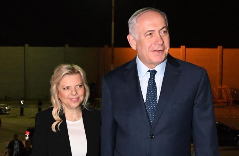 Prime Minister Netanyahu and his wife Sarah Netanyahu boarding the flight to Paris France (photo credit: CHAIM TZACH/GPO)