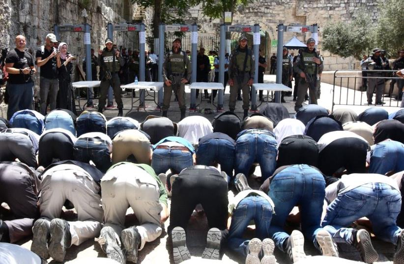 Muslims pray outside the Temple Mount as Israel tightens security (photo credit: MARC ISRAEL SELLEM)