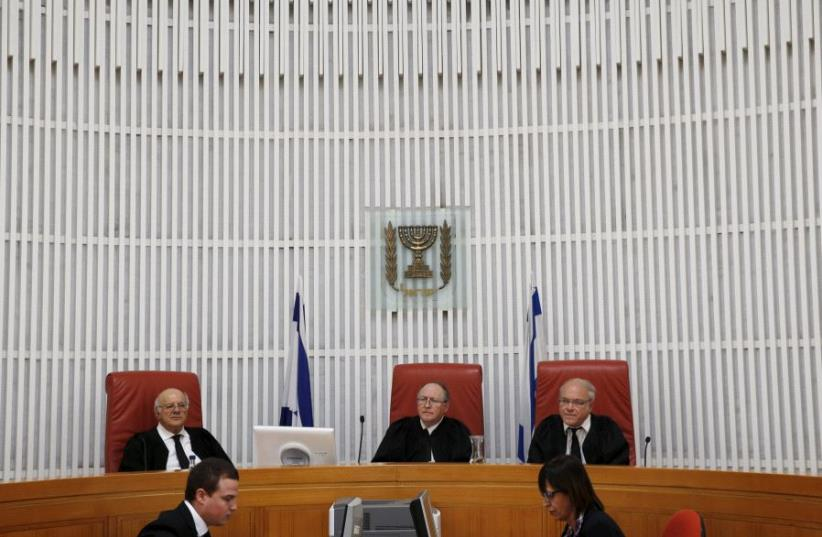 The Supreme Court in Jerusalem hearing a case. (photo credit: REUTERS)