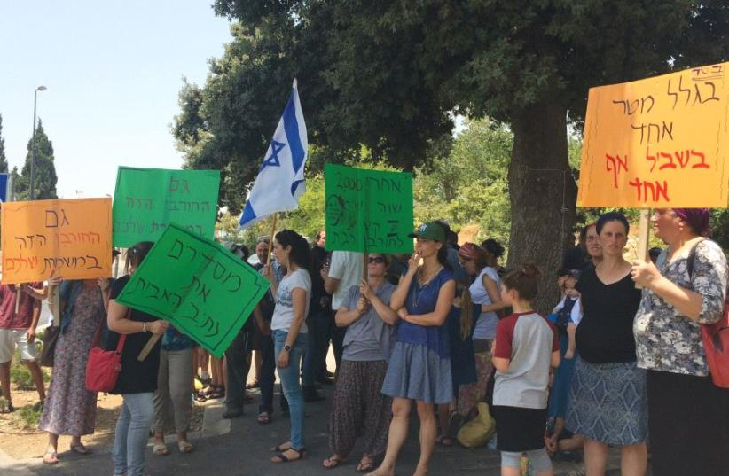 NETIV HA'AVOT residents demonstrate yesterday in front of the Knesset (photo credit: TOVAH LAZAROFF)
