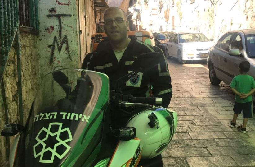 Nedal Sader with his ambucycle in Jerusalem's Old City (photo credit: COURTESY UNITED HATZALAH)