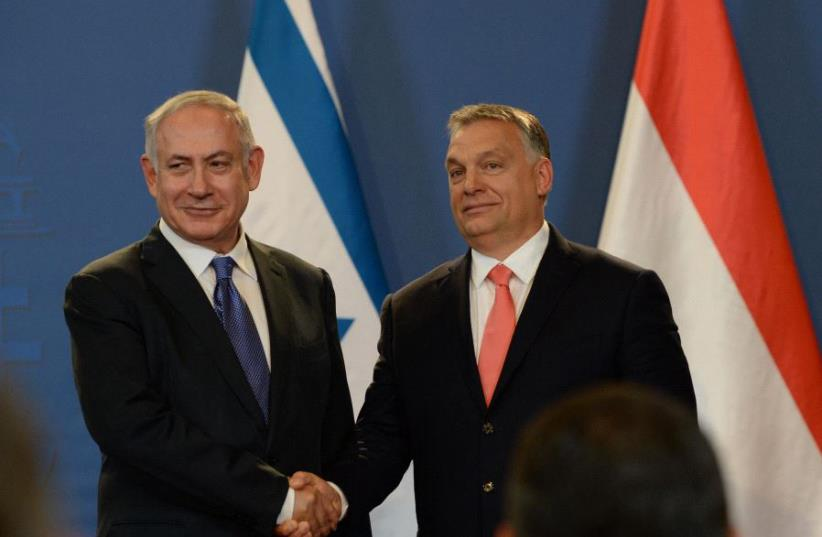 Netanyahu and Orban (photo credit: CHAIM ZACH / GPO)