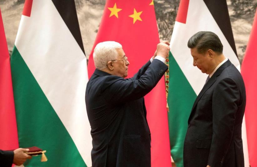 China's Xi Jinping and PA president Mahmoud Abbas in China, July 2017 (photo credit: REUTERS)