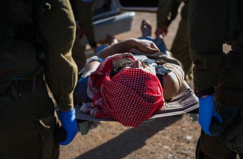 IDF troops provide medical aid to Syrian civilians (photo credit: IDF SPOKESMAN'S UNIT)