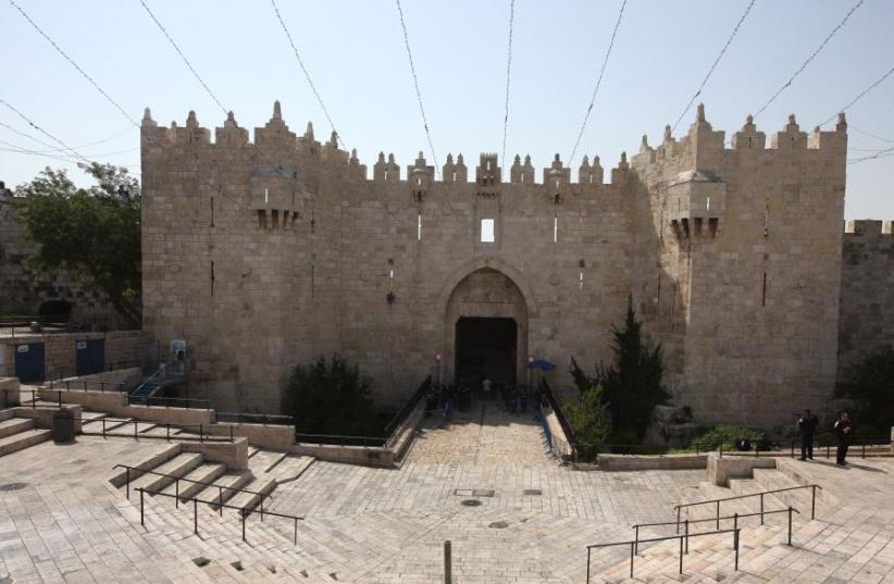 A general view of the Damascus Gate, which leads to the Old City's Muslim Quarter, July 21 2017 (photo credit: MARC ISRAEL SELLEM/THE JERUSALEM POST)