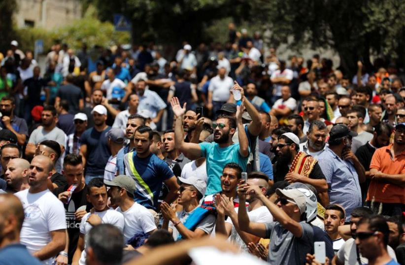 Palestinians shout slogans as they protest outside Jerusalem's Old city July 21, 2017. (photo credit: REUTERS)