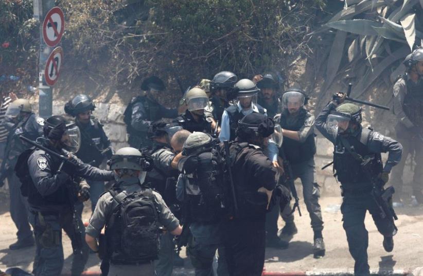Israeli police detains a Palestinian  (photo credit: RONEN ZVULUN / REUTERS)