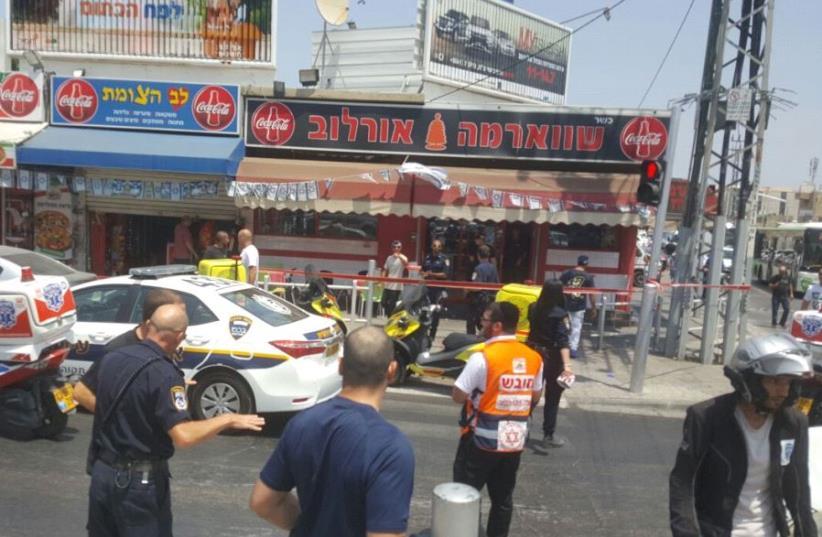 Scene of stabbing attack in Petah Tikva (photo credit: ALON HACHMON)