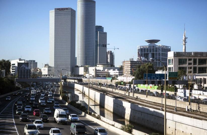 Vehicles drive on a highway in the central Israeli city of Tel Aviv December 17, 2013.  (photo credit: REUTERS)