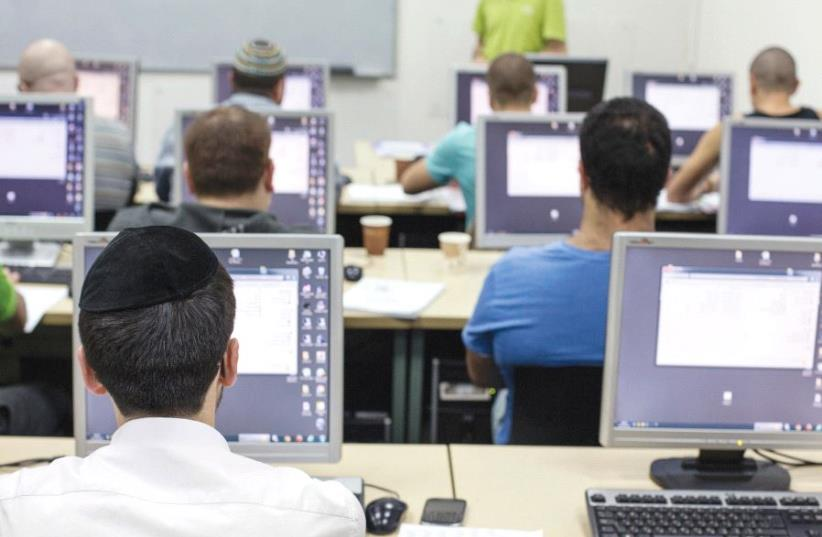 STUDENTS ATTEND a computer course at a technical college in Jerusalem (photo credit: REUTERS)