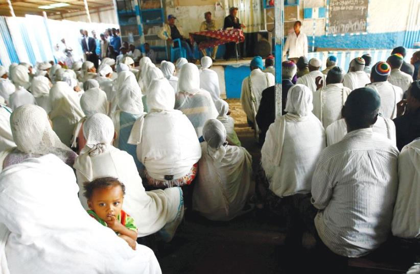 MEMBERS OF the Falash Mura Jewish Ethiopian community attend a prayer service at the HaTikvah Synagogue in Gondar, northern Ethiopia, last September (photo credit: REUTERS)