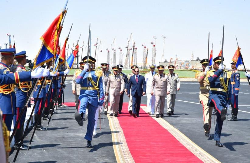 Egyptian President Abdel Fattah al-Sisi (C) arrives at the opening of the Mohamed Najib military base (photo credit: COURTESY OF THE EGYPTIAN PRESIDENCY)