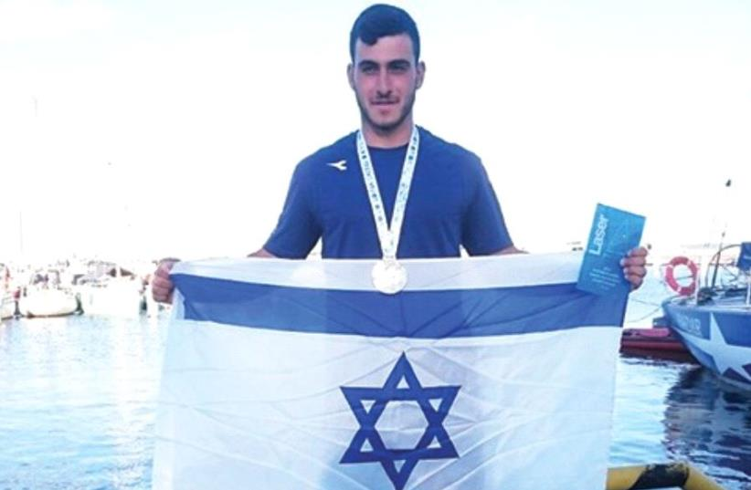 Israeli junior sa ilor Maor Ben-Harosh had every reason to celebrate his recent success at the under-19 European Championships after his future in the sport looked be doomed when both his legs were broken in a carramming incident last year. (photo credit: ISRAEL SAILING ASSOCIATION/COURTESY)