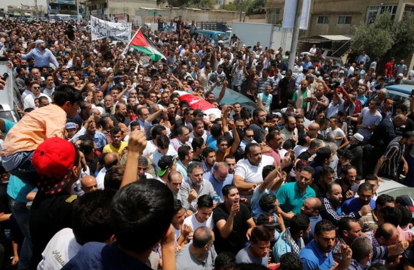 People attend the funeral of Mohammad Jawawdah in Amman, Jordan July 25, 2017.  (photo credit: REUTERS)
