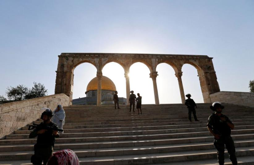 Israeli security forces stand at the compound known to Muslims as Noble Sanctuary and to Jews as Temple Mount, after Israel removed all security measures it had installed at the compound, and Palestinians entered the compound in Jerusalem's Old City July 27, 2017. (photo credit: REUTERS)
