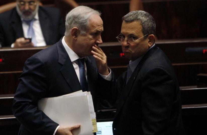 Israel's Prime Minister Benjamin Netanyahu (L) speaks with Ehud Barak at the Knesset, the Israeli parliament, in Jerusalem June 8, 2009. (photo credit: REUTERS)