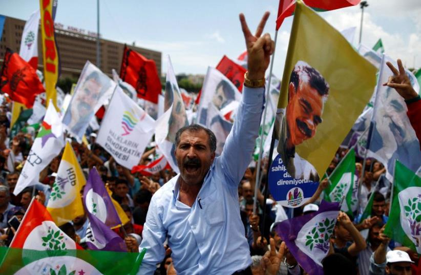 Pro-Kurdish demonstrators attend a rally as they shout slogans in Istanbul, Turkey, June 5, 2016.  (photo credit: REUTERS)