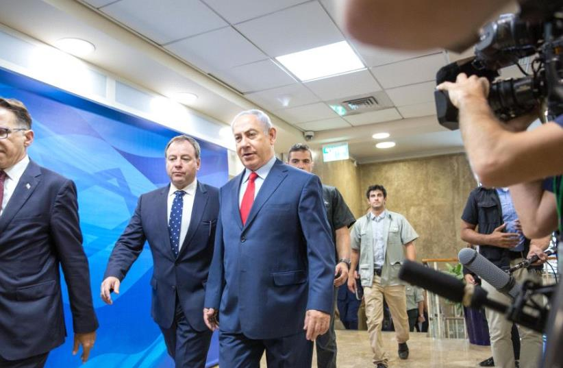 Prime Minister Benjamin Netanyahu enters a security cabinet meeting, August 2017 (photo credit: MARC ISRAEL SELLEM/THE JERUSALEM POST)