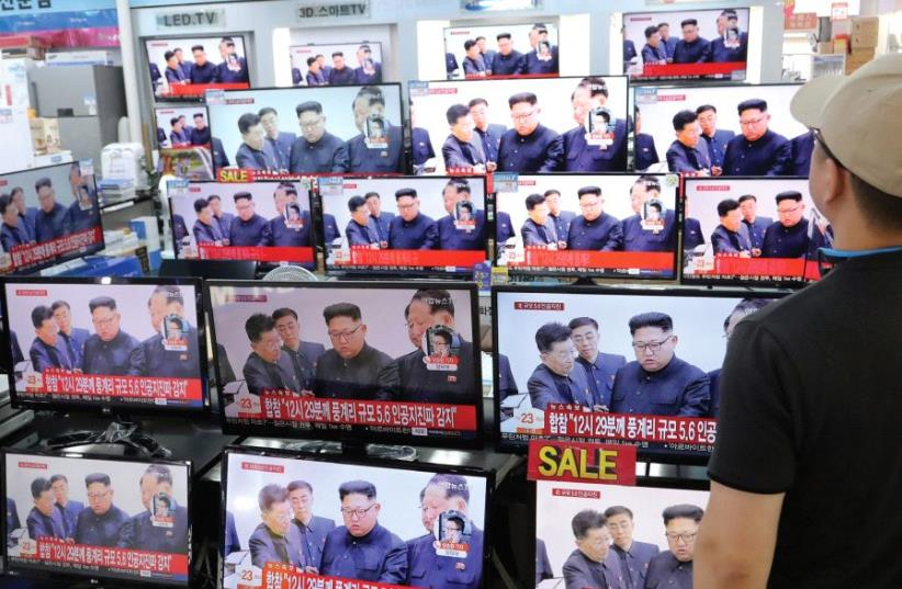 A MAN watches images of North Korean's leader on September 2nd in Seoul, South Korea. (photo credit: REUTERS)