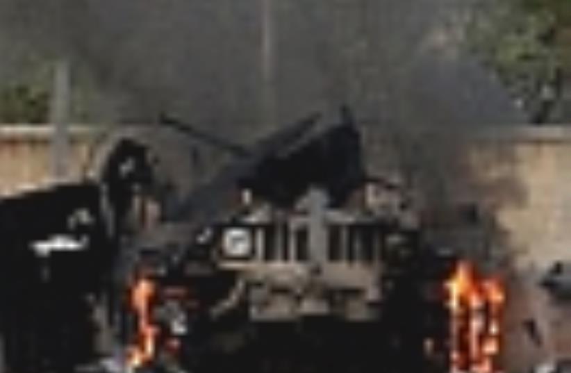 iraq US humvee burns 88 (photo credit: aP)