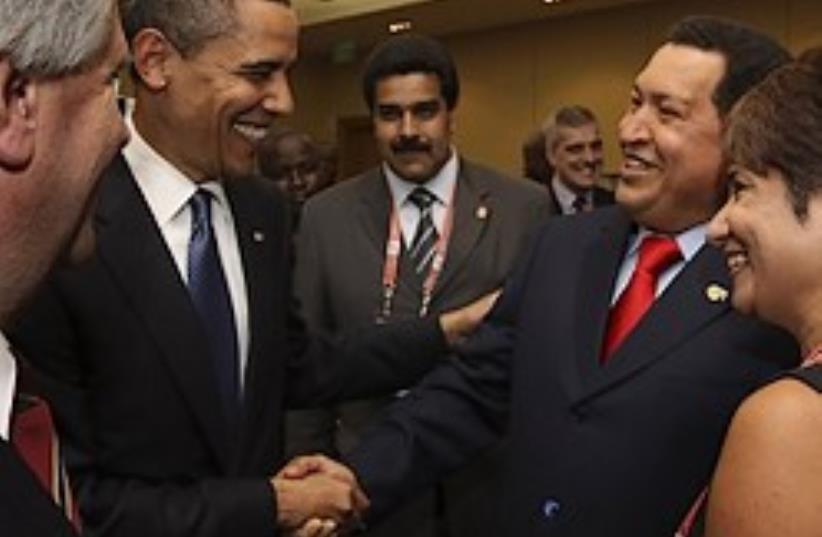 obama chavez 248.88 check caption (photo credit: AP)