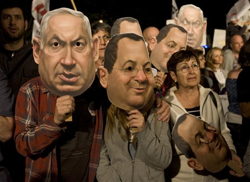 Israeli left-wing activists wearing masks of Prime