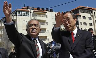 UN Secretary General Ban Ki-moon, right, gestures with Palestinian Authority Prime Minister Salam Fayyad, during a tour of the West Bank city of Ramallah, Saturday.