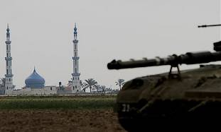 An Israeli tank is seen on the Israel Gaza Strip b