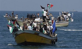 Palestinians ride boats in Gaza waters and an Isra