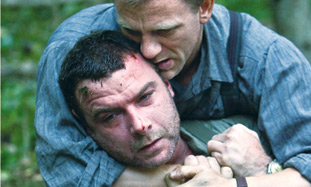 Daniel Craig as Tuvia Bielski and Liev Schreiber a