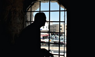 JERUSALEM MAYOR Nir Barkat looks out a window at H
