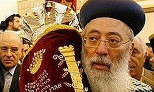 Chief Sepharadic rabbi Shlomo Amar holds a Torah.