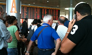 Passengers at Ben Gurion airport, Monday