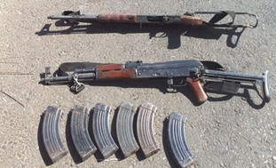 AK-47s taken from the dead Hamas men in Hebron