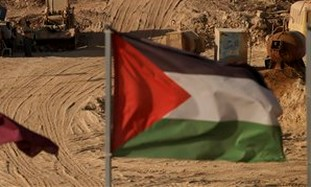 Palestinian flag in front of dirt