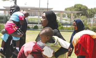 A family of African migrants outside the Knesset