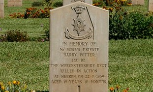 A tombstone bearing the name of a British Private.