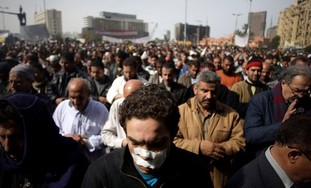 Anti-government protestors pray in Tahrir Square,