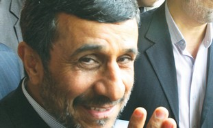 Ahmadinejad waves to media