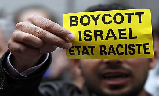 A protester calling for a boycott of Israel